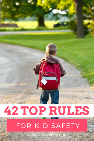 42 rules to teach kids safety checklist cover - a boy with a backpack in a park